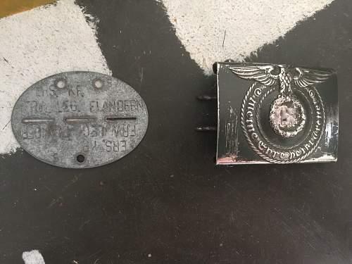 Steel SS belt buckle unmarked genuine?