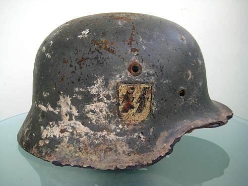 Need help! Cheap SS helmet full of holes genuine?