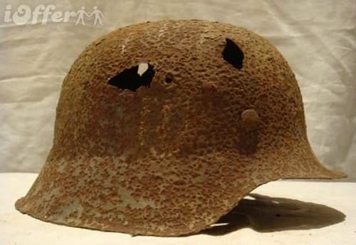 Click image for larger version.  Name:original-ww2-german-m42-ss-helmet-from-kurland-latvia-60f7.jpg Views:499 Size:65.7 KB ID:361209