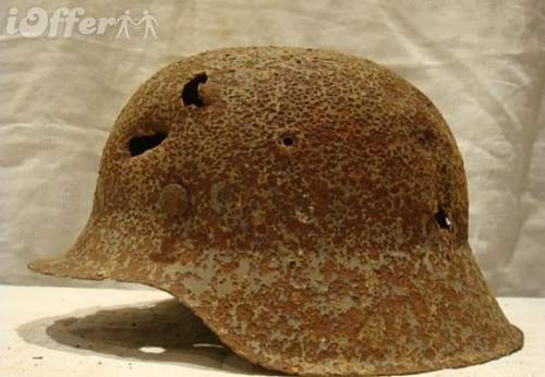 Click image for larger version.  Name:original-ww2-german-m42-ss-helmet-from-kurland-latvia-dbe7.jpg Views:371 Size:69.7 KB ID:361211