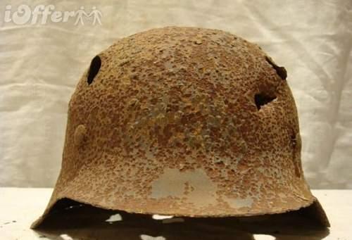 Click image for larger version.  Name:original-ww2-german-m42-ss-helmet-from-kurland-latvia-e92e.jpg Views:250 Size:66.5 KB ID:361212