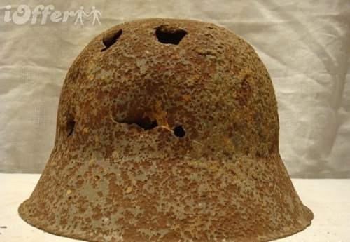 Click image for larger version.  Name:original-ww2-german-m42-ss-helmet-from-kurland-latvia-2ef9.jpg Views:38 Size:71.4 KB ID:361352