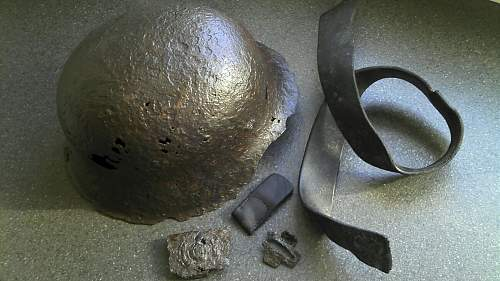 SS-relics - m42 helmet, leatherbelt and SS-belt buckle.
