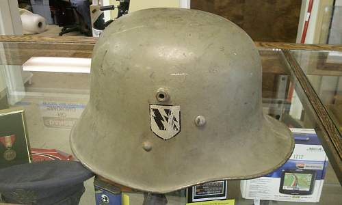Help in identification and authenticity. SS and swastika green helmet