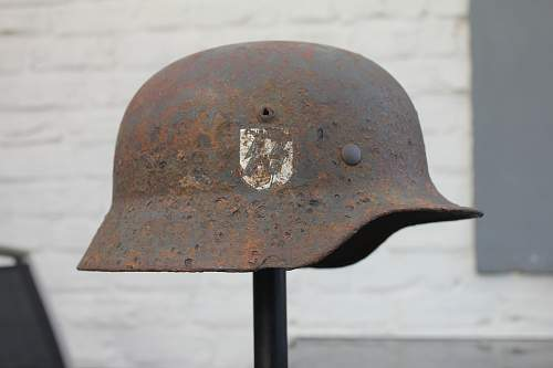 Can anyone help me to identify the name in my M35 SS dd semi relic