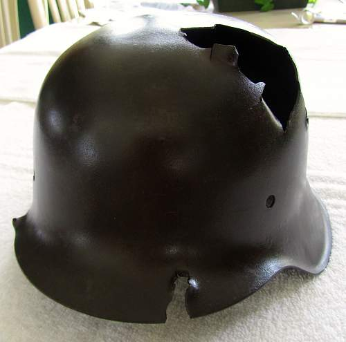 Looking for Opinions on My Battle-Damaged M42 SS Helmet