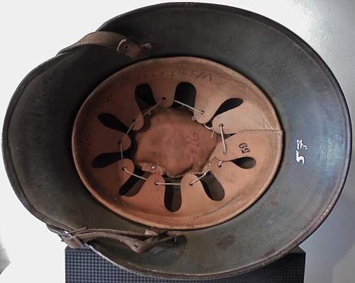 One SS DD M17 Austrian Helm with strange mirrored runes (???) Opinions needed