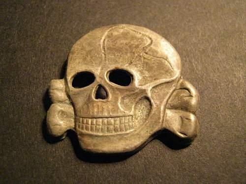 a trio of strange skulls