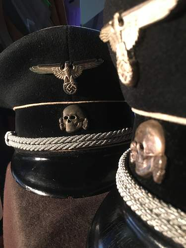 You want a black SS peaked cap?
