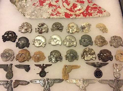 Large collection of SS metal insignia and buckles in dug / battlefield condition