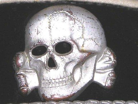 SS scull zinc, fake