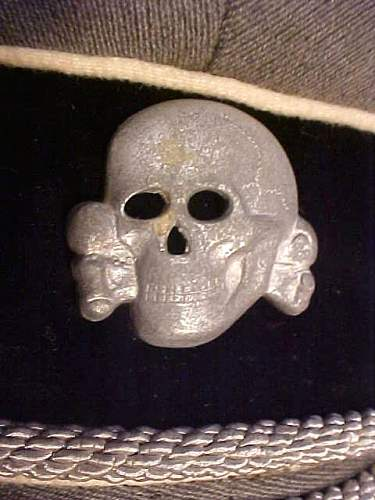 SS scull zinc, fake