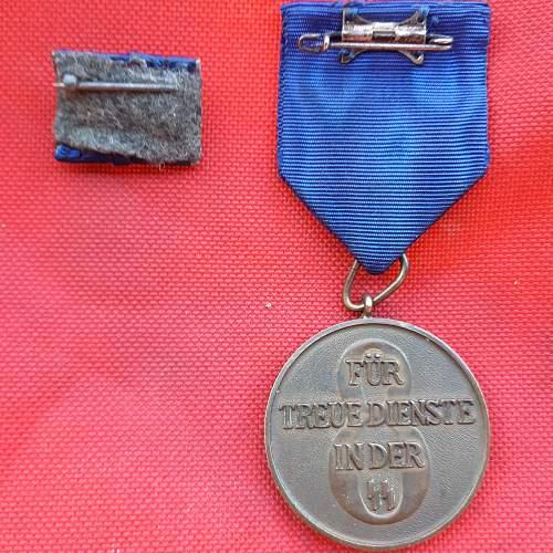 SS 8yr long service medal and ribbon bar....