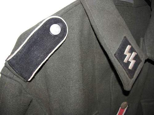 Waffen-SS late M44 model tunic for inspection.