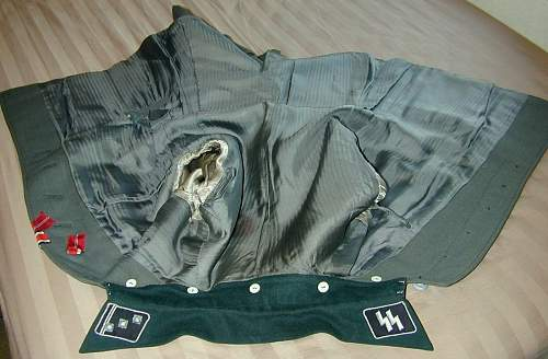 Waffen SS tunic, and breeches for viewing...