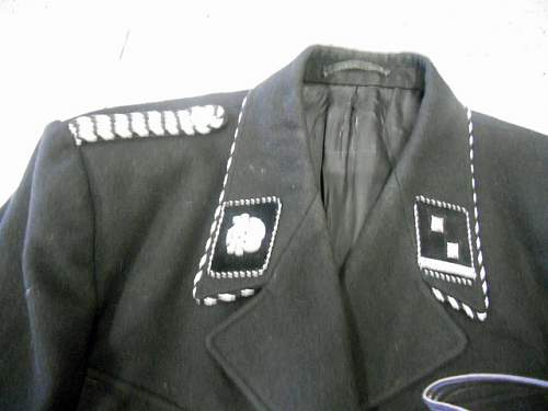 What kind of uniform and does it look like a reproduction or not?  Help