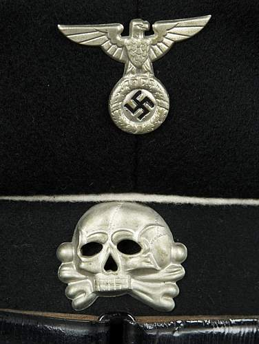 SS cap in Poland and its cousin