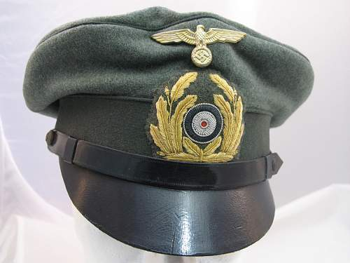 SS and Reichswehr caps, leather peak and novel chin straps