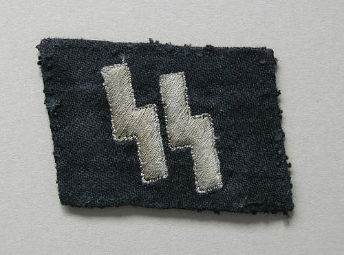 Nice pair of worn runic collar tabs