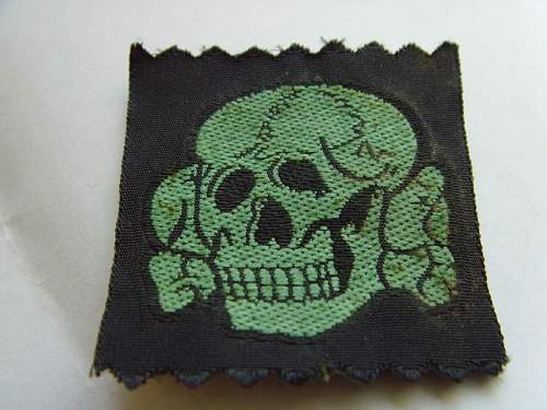 Pair of Bevo cloth cap skulls: repro's ?