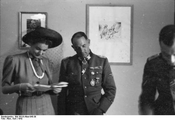 Click image for larger version.  Name:Bundesarchiv_Bild_101III-Alber-045-30,_Berlin,_Sepp_Dietrich_mit_Ehefrau.jpg Views:589 Size:40.7 KB ID:21851