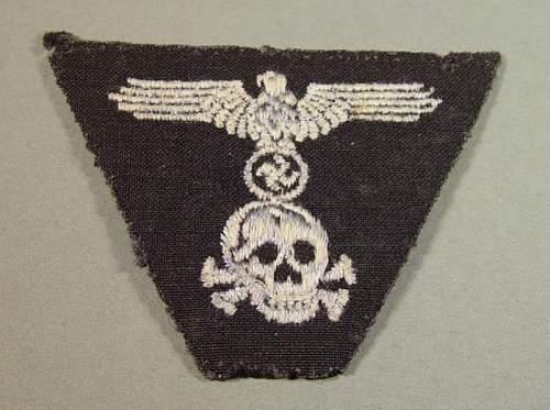 Black trapezoid cap insignia