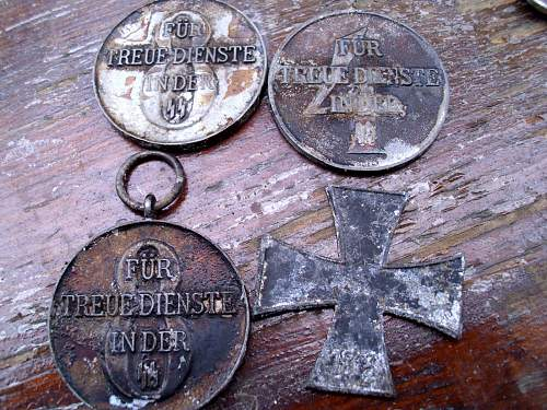 Ground Dug SS Medals and Skull Buttons, check the medal loop
