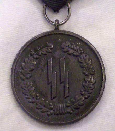 SS 4 year service medal.............. i am pretty sure it is fake, any help.