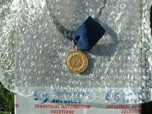 Click image for larger version.  Name:12y service medal back.jpg Views:205 Size:189.0 KB ID:29583