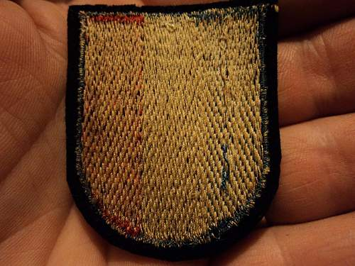 French  Vol. sleeve shield, real?