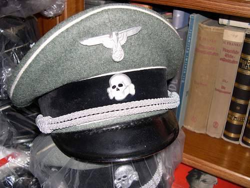 Grey peaked cap and its passage through space.