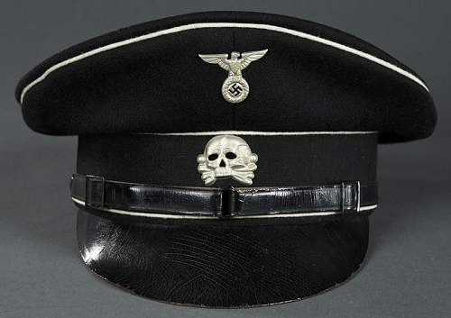early black SS peaked cap: a study in contrasts.
