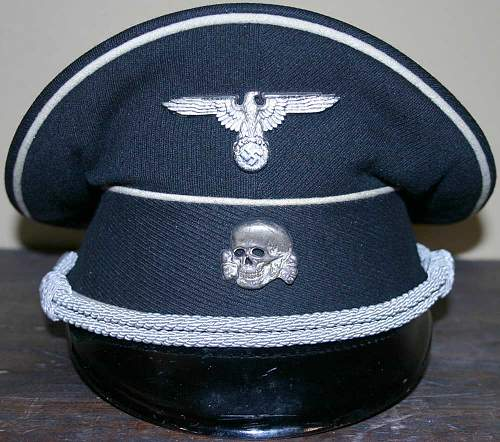 Caps from the Fa. Kornacker, ca. 1938, includes an officer redecorate from enlisted.