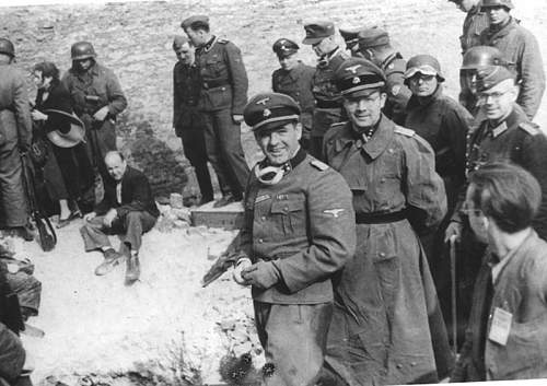 Click image for larger version.  Name:Warsaw, Poland, April 1943 Stroop beside Jews who were forced out of a bunker during the ghetto .jpg Views:16559 Size:99.9 KB ID:491990