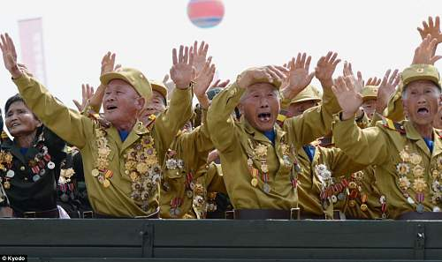 Click image for larger version.  Name:cheering north koreans..jpg Views:168 Size:81.9 KB ID:769681