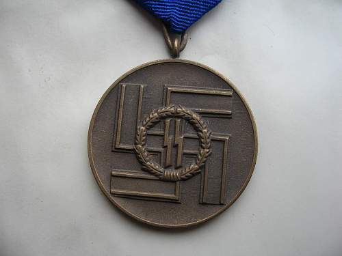 is this an original ss 8yr medal