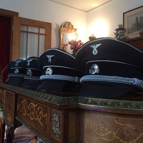 black SS officer caps, leather peaks