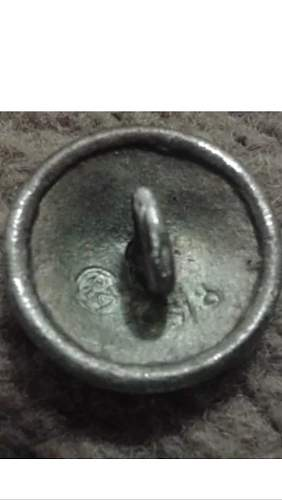 Genuine SS cap button?