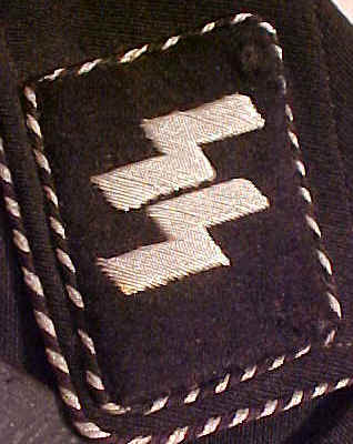 Any of these collar tabs have a chance?