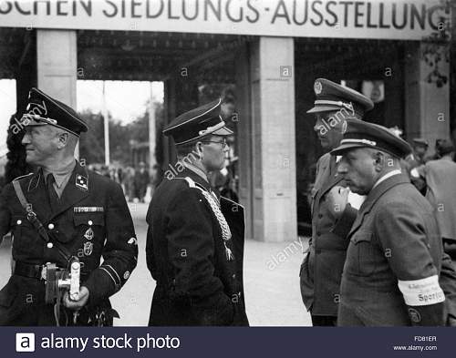 Click image for larger version.  Name:philipp-bouhler-in-munich-around-1934-FD81ER copy.jpg Views:54 Size:134.1 KB ID:991438