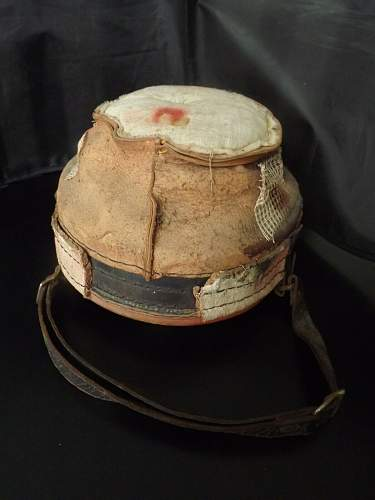 M34 Helmet Liner with post war red paint.