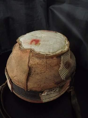 M34 Helmet Liner with post war red paint.