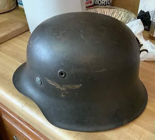 LW Helmet with apparent bullet/shrapnel hit