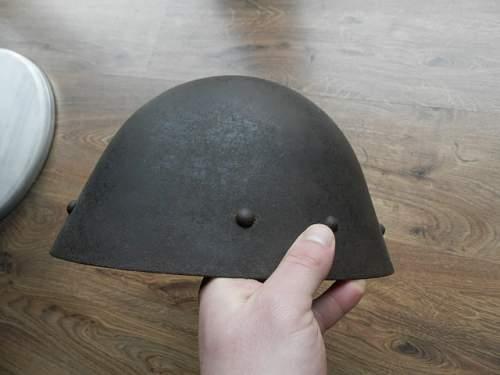 steel helmet bullet hole?