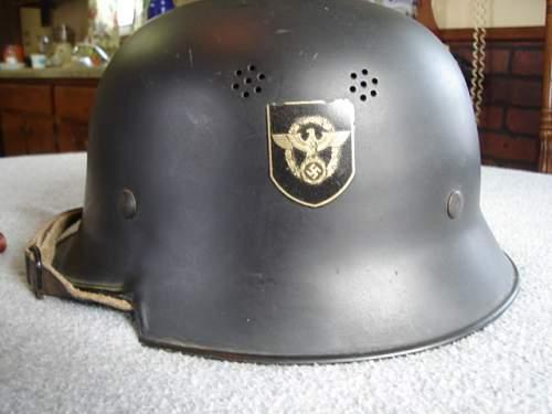 Aluminium parade helmet or postwar fire?