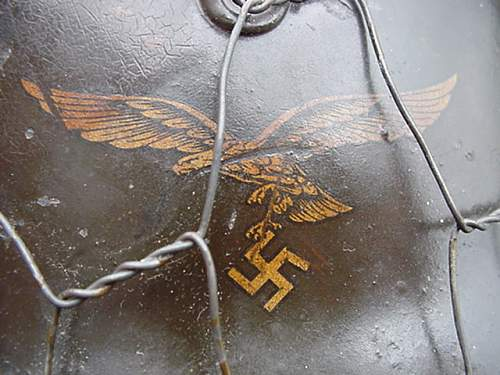 Need some help with is m40 luftwaffe helmet w/ chicken wire cover