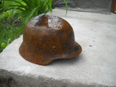 Battledamaged M35 helmet  from Kurland pocket