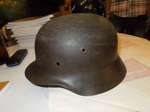 A Luftschutz and an SS helmet