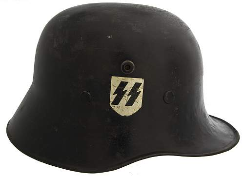 Click image for larger version.  Name:German_SS_Commercially-Produced_'Droop-Bill'_M-18_Helmet 1.jpg Views:489 Size:171.5 KB ID:413021