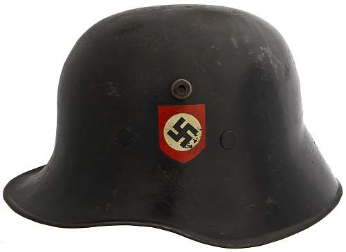 Click image for larger version.  Name:German_SS_Commercially-Produced_'Droop-Bill'_M-18_Helmet.jpg Views:351 Size:182.5 KB ID:413022